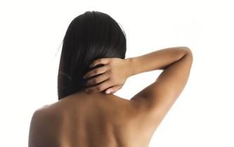 woman-hand-on-back-neck_925x